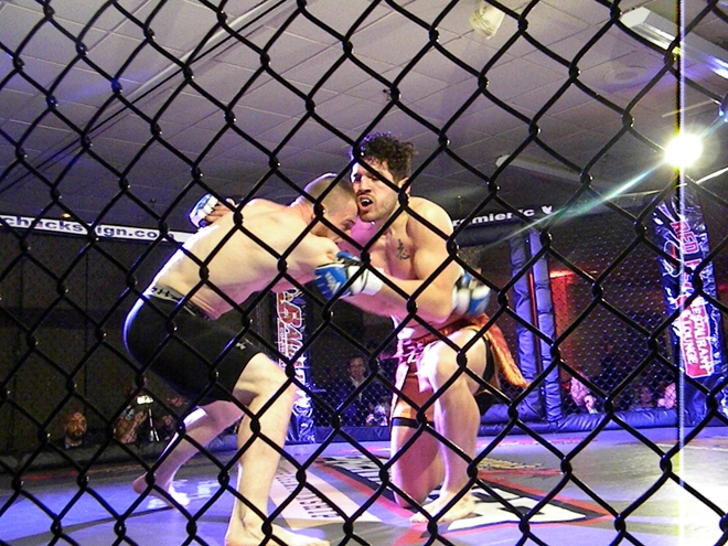 "Pat ""the Ninja Gorilla"" Casey, left, and Angelo Richardson battle March 11 at Premier FC 22 in Agawam, MA"