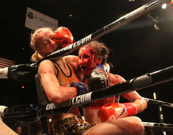 Andra Aho, left, is pinned by a blood drenched Jeri Sitzes on March 3 at Lion Fight 35.