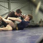 Damian Roofy, left, and Matt Bienia grapple on Feb. 25.