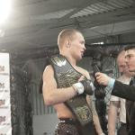 Vovka Clay, left, holding the lightweight title belt that he won on Feb. 25 at AFL 1.