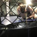 Mike Kimbel attempts to secure a guillotine choke on Randy Francis during AFL 1 on Feb. 25.